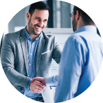 Smiling businessman shaking hands with business partner
